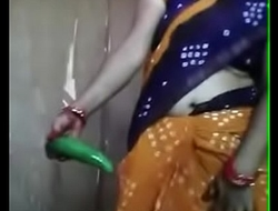 Desi aunty playing with cucumber