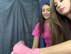 Two Cute Nurses Giving a Handjob