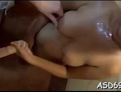Lusty asian sex doll gives a one-eyed monster ride and a perfect tugjob
