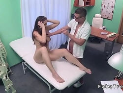Hot brunette in thong gets examined
