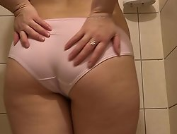 The brunette in the shower stall inform on her wet panties with an increment of fucked her hairy pussy with a bottle.