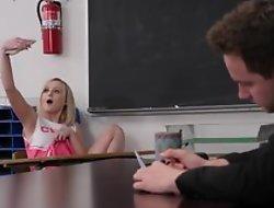 Horny professor copulates petite cheerleader in the classroom