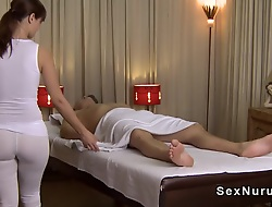 Busty masseuse in all directions undershirt gives massage
